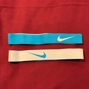 2 Nike swoosh headbands